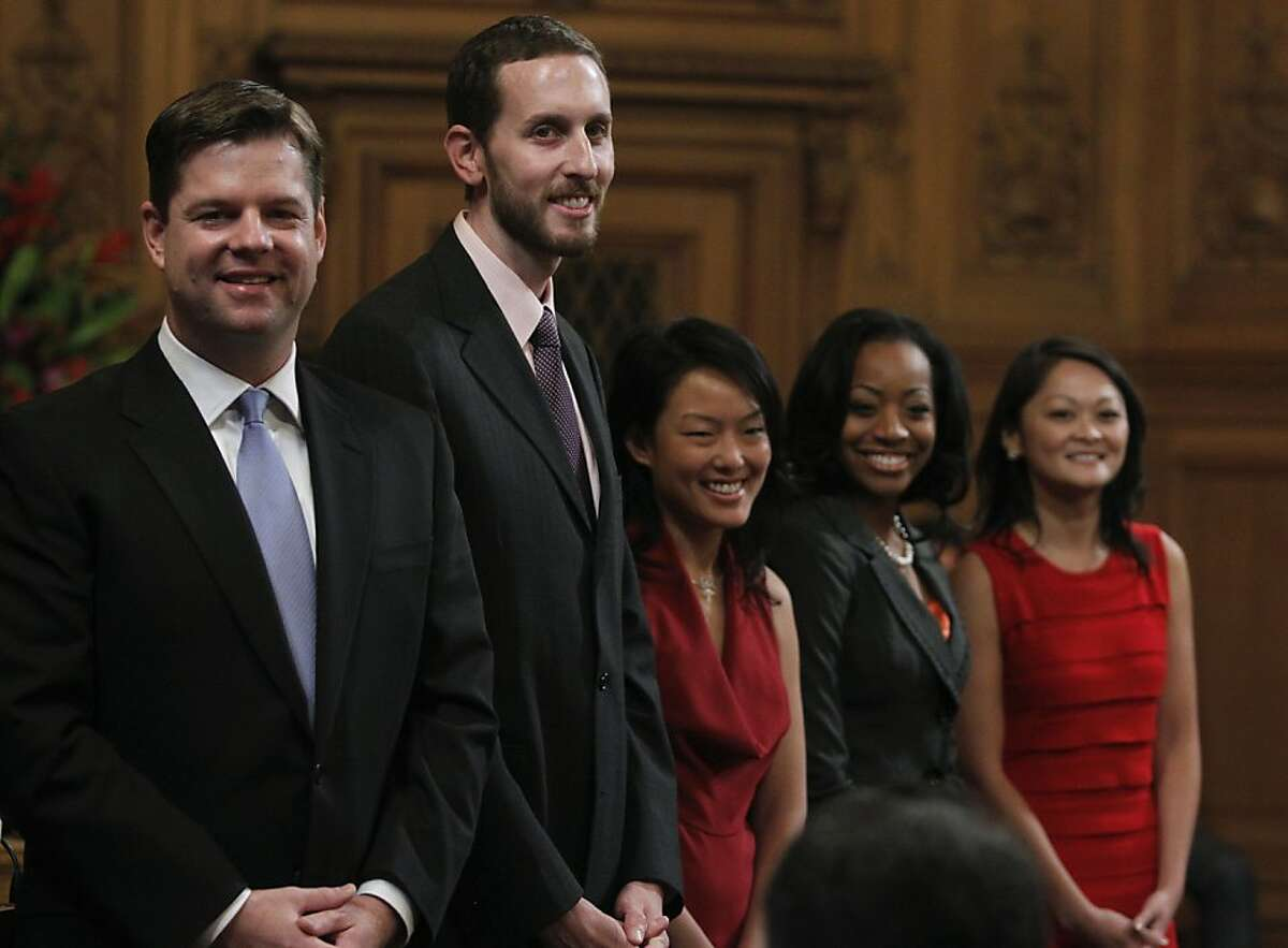 From left, Mark Farrell, Scott Wiener, Jane Kim, Malia Cohen and incumbent Carmen Chu smile before they are sworn in to serve on the Board of Supervisors at City Hall in San Francisco on Saturday.