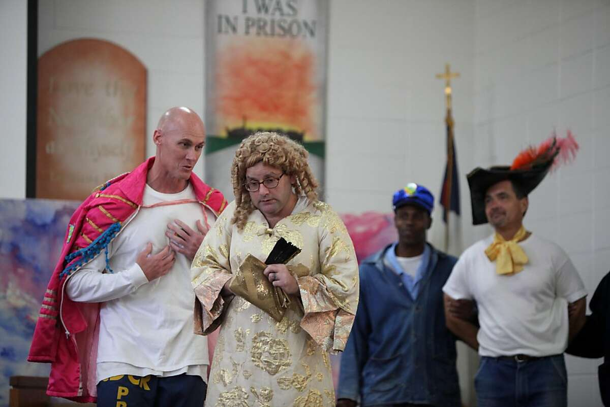 """Erin O'Connor and Mike Anthony (l to r foreground) perform as Orsino and Olivia perform in """"Twelfth Night"""" at San Quentin State Prison on Friday, August 5, 2011 in San Quentin, Calif. The inmates under the direction of the Marin Shakespeare Company's Suraya Keating, have been preparing for the performance for the past 10 months."""