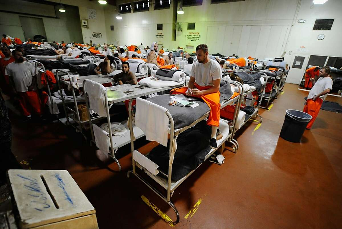 Inmates at Chino State Prison, which houses 5500 inmates, crowd around double and triple bunk beds at a gymnasium that was modified to house 213 prisoners on December 10, 2010 in Chino, California. The U.S. Supreme Court is preparing to hear arguments to appeal a federal court's ruling last year that the California state prison system would have to release 40,000 prisoners to cope with overcrowding so severe that it violated their human rights. More than 144,000 inmates are currently incarcerated in prisons that were designed to hold about 80,000.