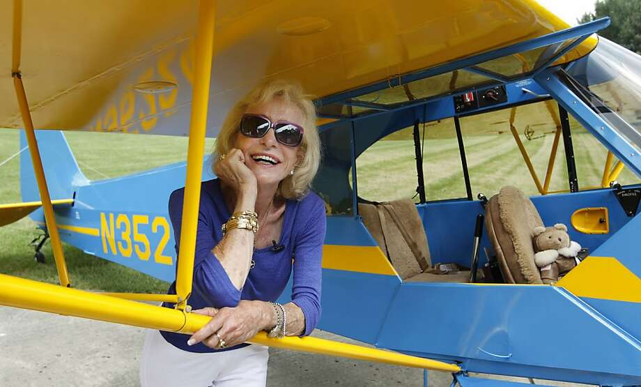 "Myrtle Rose, 75, stands by her 1941 Piper J-3 Cub named ""Winston"" on her property in South Barrington, Ill., Friday, Aug. 5, 2011. The aviation enthusiast was out for a quick flight on Wednesday, Aug. 3 when she saw two F-16 fighter jets out her cockpit window after she strayed into restricted airspace during a visit to Chicago by President Barack Obama. Rose says she's filed a report with the Federal Aviation Administration explaining she didn't know she wasn't supposed to fly in the area that day. Photo: M. Spencer Green, AP"