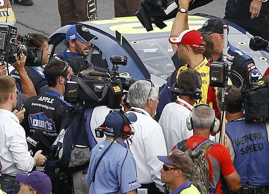Jimmie Johnson, left, and Kurt Busch exchange words on pit road after the NASCAR Sprint Cup Series auto race, Sunday, Aug. 7, 2011, at Pocono Raceway in Long Pond, Pa. Photo: Matt Slocum, AP