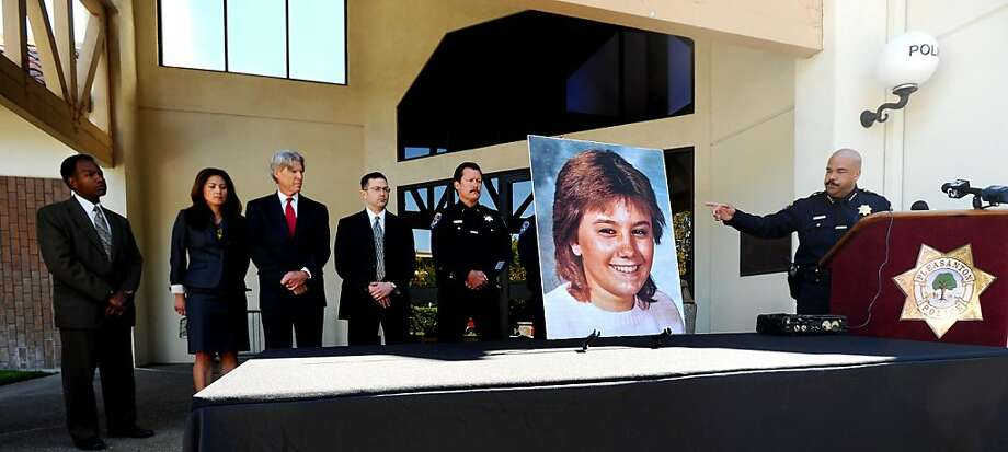 Law enforcement personnel stand behind a photo of Tina Faelz, who was 14 years old when murdered, during a press conference at the Pleasanton Police Department on Monday, Aug. 8, 2011, in Pleasanton, Calif. Pleasanton Police Chief David Spiller, right, announced Monday that investigators have arrested a suspect in the 1984 stabbing case using DNA evidence. Photo: Noah Berger, Special To The Chronicle