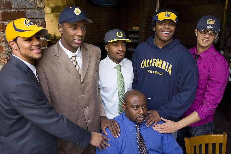 From left, Keenan Allen, Chris McCain, James Scales, Gabe King and Zach Maynard  pose for a photo with Otis Yelverton during High School National Signing Day, Wednesday, Feb. 3, 2010 in Greensboro, N.C.    (AP Photo/News & Record, Jerry Wolford)     Ran on: 02-04-2010 From left, Keenan Allen, Chris McCain, James Scales, Gabe King and Zach Maynard with coach Otis Yelverton during signing day in Greensboro, N.C. Photo: Jerry Wolford, AP