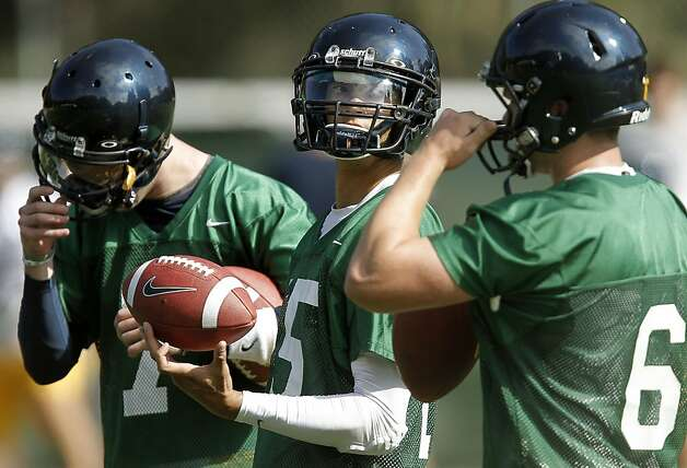 Quarterbacks, Austin Hinder, (7) Zach Maynard, (15) and Kyle Boehm, (6) during practice, as the UC Berkeley Golden Bears football team opens their fall training camp in Berkeley, Ca. on Saturday August 6, 2011. Photo: Michael Macor, The Chronicle