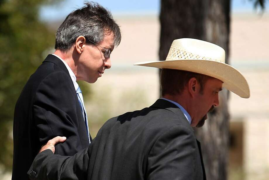 "Warren Jeffs, leader of the Fundamentalist Church of Jesus Christ of Latter Day Saints, left, is led out of the Tom Green County Courthouse in San Angelo, Texas Tuesday, Aug. 9, 2011. The polygamist leader was sentenced to life in prison for sexually assaulting two underage followers he took as brides in what his church deemed ""spiritual marriages."" Photo: Patrick Dove, AP"