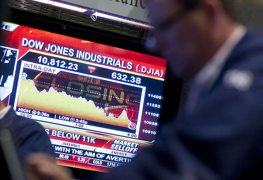 A television monitor displays the Dow Jones Industrial Average on the floor of the New York Stock Exchange near the close on Monday, Aug. 8, 2011 in New York. The Dow Jones industrials closed down 634 points, or 5.5 percent, to 10,809 Monday. It was the first time the Dow fell below 11,000 since November and its biggest one-day point drop since December 2008. (AP Photo/Jin Lee) Photo: Jin Lee, AP