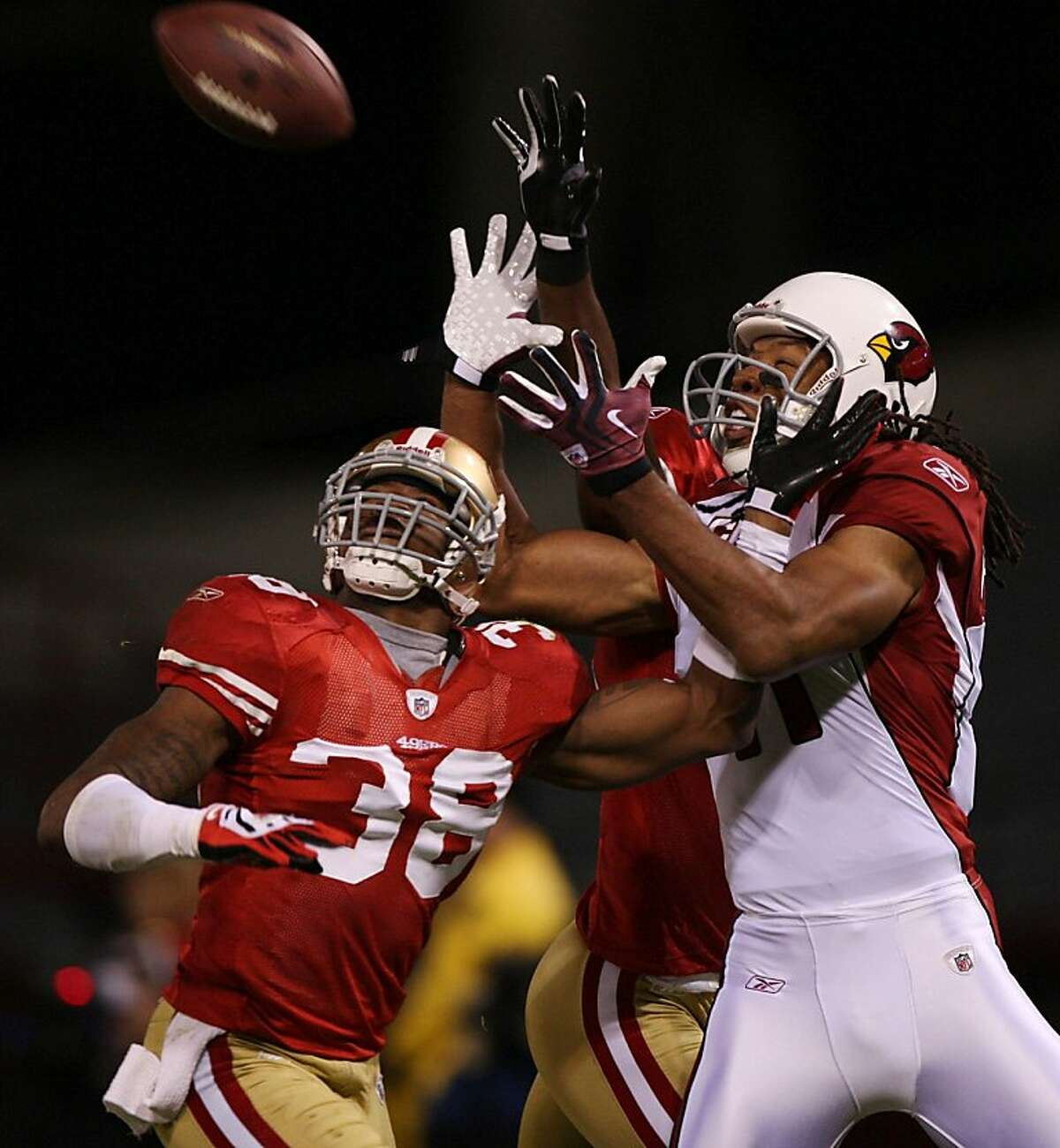 SAN FRANCISCO - DECEMBER 14: Wide receiver Larry Fitzgerald #11 of the Arizona Cardinals goes up for a catch as it is broken up by Dashon Goldson #38 of the San Francisco 49ers in the first half at Candlestick Park on December 14, 2009 in San Francisco, California. The pass was ruled incomplete after a Cardinals challenge. (Photo by Jed Jacobsohn/Getty Images)