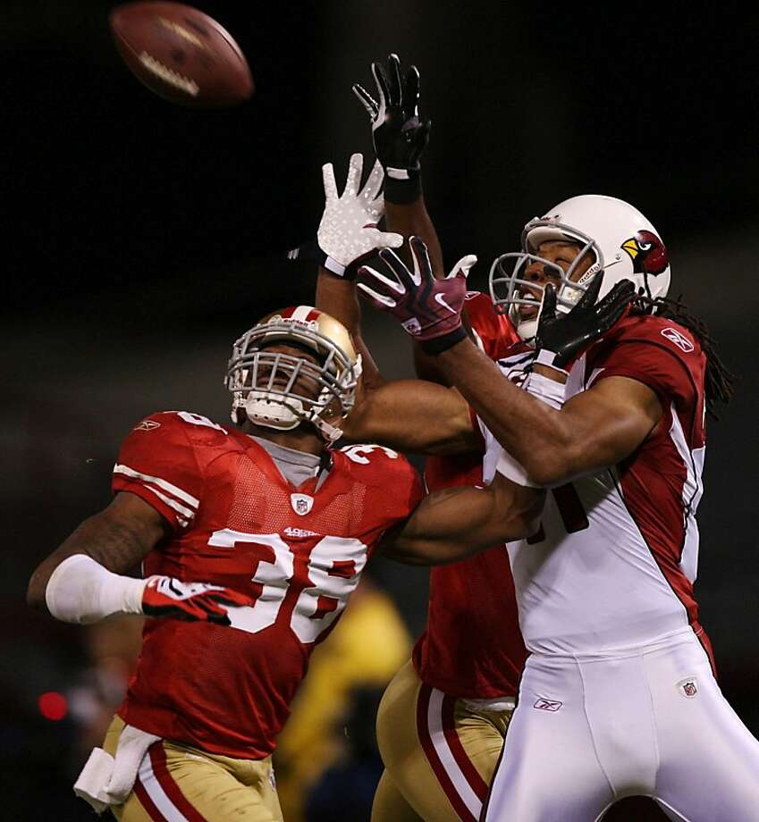 SAN FRANCISCO - DECEMBER 14:  Wide receiver Larry Fitzgerald #11 of the Arizona Cardinals goes up for a catch as it is broken up by Dashon Goldson #38 of the San Francisco 49ers in the first half at Candlestick Park on December 14, 2009 in San Francisco, California. The pass was ruled incomplete after a Cardinals challenge. (Photo by Jed Jacobsohn/Getty Images) Photo: Jed Jacobsohn, Getty Images