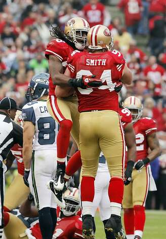 Dashon Goldson and Justin Smith celebrate a stop for no gain by the Seahawk's Justin Forsett. The San Francisco 49ers played the Seattle Seahawks at Candlestick Park in San Francisco, Calif., on Sunday, December 12, 2010. The 49ers defeated the Seahawks, 40-21. Photo: Carlos Avila Gonzalez, The Chronicle