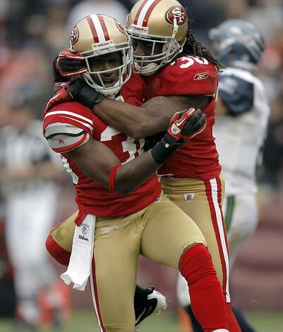 Reggie Smith (left) celebrates his first quarter interception with Dashon Goldson. The San Francisco 49ers play the Seattle Seahawks at Candlestick Park in San Francisco, Calif., on Dec. 12, 2010. The 49ers defeated the Seahawks 40-21. Photo: Michelle Gachet, The Chronicle