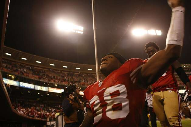 San Francisco 49ers Dashon Goldson waves to the crowd of fans after defeating the Arizona Cardinals, 24-9, Monday Dec. 14, 2009, in San Francisco, Calif.     Ran on: 12-15-2009 Photo caption Dummy text goes here. Dummy text goes here. Dummy text goes here. Dummy text goes here. Dummy text goes here. Dummy text goes here. Dummy text goes here. Dummy text goes here.###Photo: 49ers15_PH1260662400SFC###Live Caption:San Francisco 49ers Dashon Goldson waves to the crowd of fans after defeating the Arizona Cardinals, 24-9, Monday Dec. 14, 2009, in San Francisco, Calif.###Caption History:San Francisco 49ers Dashon Goldson waves to the crowd of fans after defeating the Arizona Cardinals, 24-9, Monday Dec. 14, 2009, in San Francisco, Calif.###Notes:###Special Instructions:MANDATORY CREDIT FOR PHOTOG AND SF CHRONICLE-NO SALES MAGS OUT-INTERNET OUT-TV OUT-INTERNET: AP MEMBER NEWSPAPERS ONLY Photo: Lacy Atkins, The Chronicle