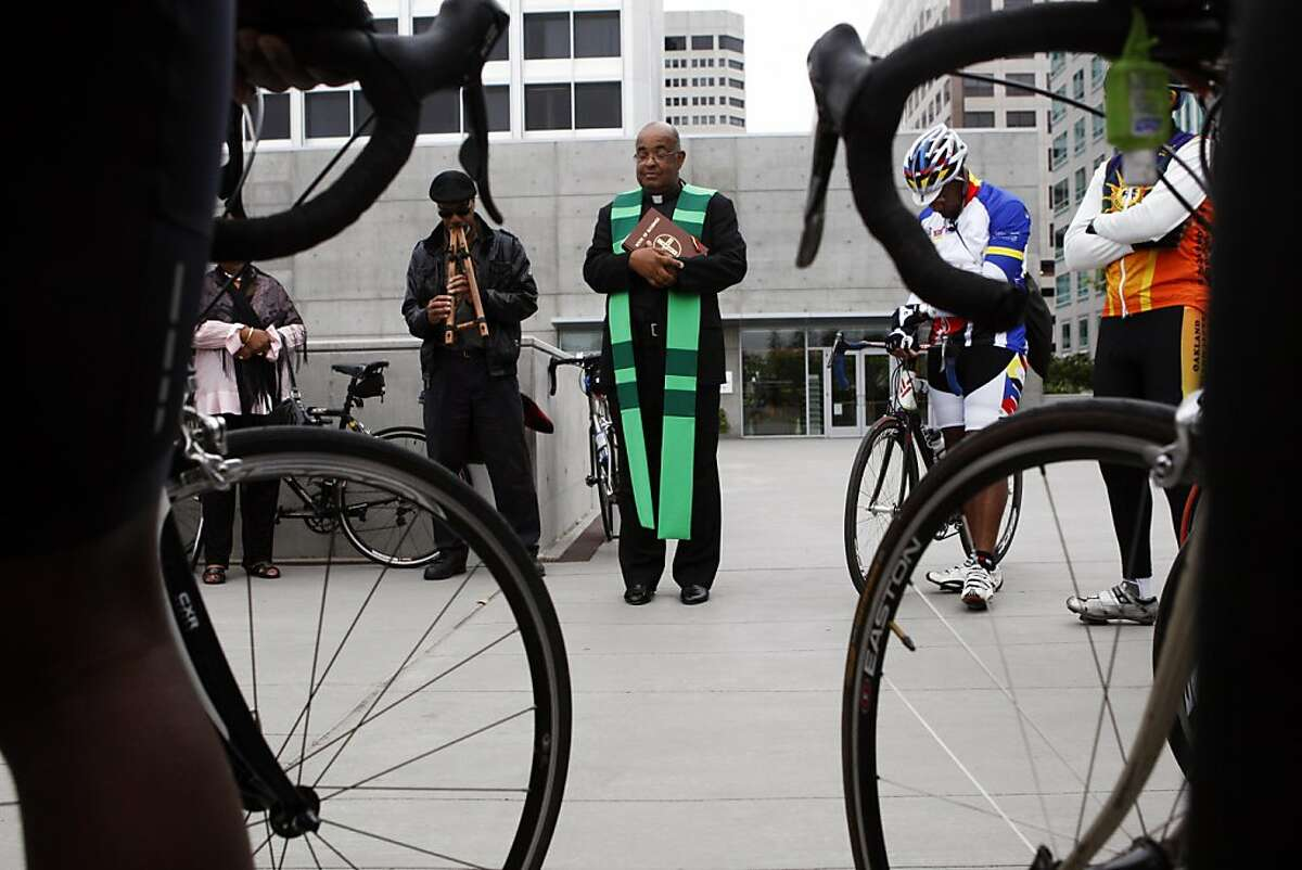 Father Jay Matthews blesses a group of bicylists. A blessing of bicycles of a national black bicyclists association was held at the Cathedral of Christ the Light in Oakland, Calif. on Sunday, August 7, 2011.