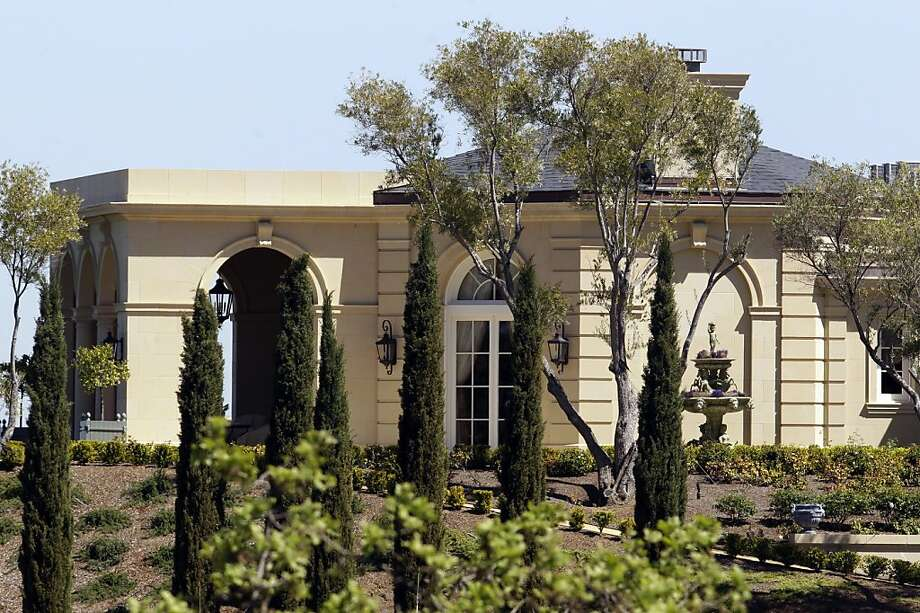 Exterior view of a $100 million mansion in Los Altos Hills, Calif., Thursday, March 31, 2011. A Russian billionaire investor has purchased a lavish, 25,500-square-foot mansion in Silicon Valley for $100 million, believed to be the most ever paid for a single-family home in the United States. The Wall Street Journal reports that 49-year-old Yuri Milner, an investor in Facebook, Groupon and Zynga, has no immediate plans to move into the home. Photo: Paul Sakuma, AP