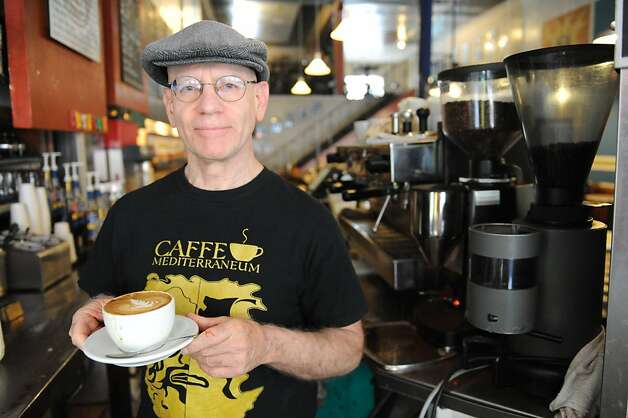 Craig Becker, coowner and manager of Caffe Mediterraneum shows off a capuccino on August 4, 2011. The cafe is the second oldest on the west coast and is also the place where the caffe latte was invented Photo: Susana Bates, Special To The Chronicle