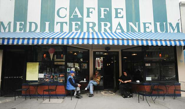 People sit outside at Caffe Mediterraneum on August 4, 2011. The cafe is the second oldest on the west coast and is also the place where the caffe latte was invented. Photo: Susana Bates, Special To The Chronicle