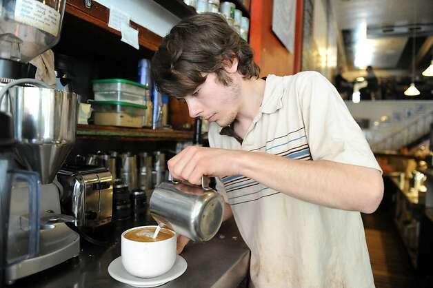 Robert Burton makes a drink at Caffe Mediterraneum on August 4, 2011. The cafe is the second oldest on the west coast and is also the place where the caffe latte was invented. Photo: Susana Bates, Special To The Chronicle