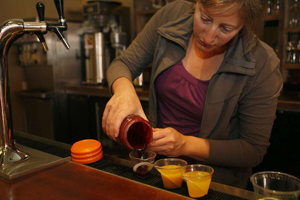 Lynn Garfinkle, co-owner of Roam restaurant, prepares to make blackberry soda on Saturday, July 30, 2011. Roam currently makes 6 different flavored sodas.