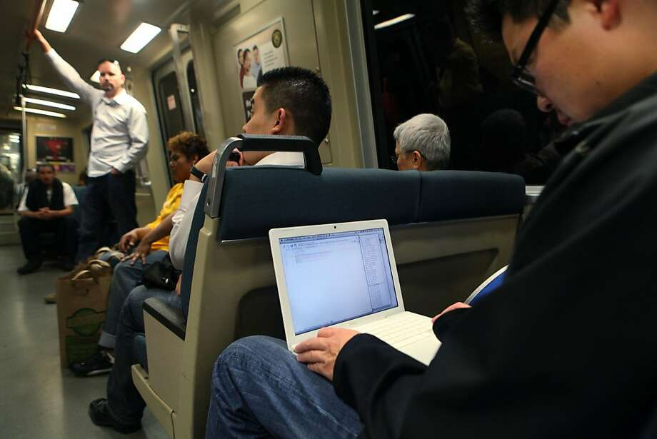 Joery van Druten works on his laptop while traveling on BART in San Francisco Calif.,  on August 5, 2011. Photo: Audrey Whitmeyer-Weathers, The Chronicle