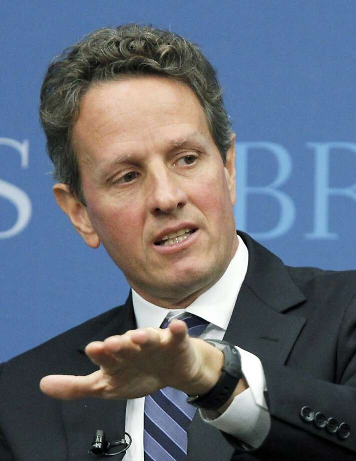 "In this Oct. 6, 2010 file photo, Treasury Secretary Timothy Geithner speaks at the Brookings Institution's ""The Path to Global Recovery"" forum, in Washington. Geithner has told President Barack Obama that he will remain on the job as Treasury secretary. The Treasury Department released a statement Sunday, Aug. 7, 2011, saying Geithner had informed the president of his decision to remain in the administration. Photo: Manuel Balce Ceneta, AP"