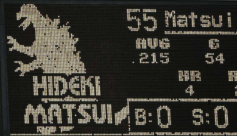 The scoreboard lights up with an image of Godzilla as Oakland Athletics' Hideki Matsui of Japan is announced during the fourth inning of a baseball game against the Kansas City Royals Tuesday, June 14, 2011, in Oakland, Calif. Matsui hit a home run in theinning. Photo: Ben Margot, AP