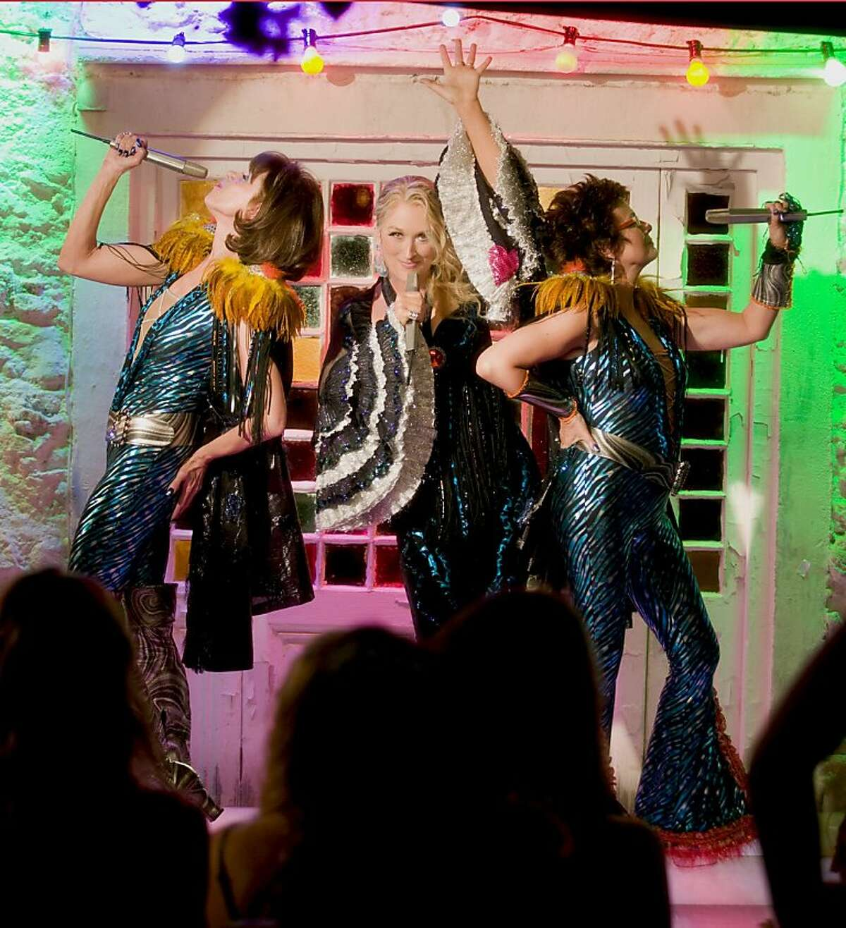 Donna and The Dynamos-(L to R) Tanya Chesham-Leigh (CHRISTINE BARANSKI), Donna Sheridan (MERYL STREEP) and Rosie Rice (JULIE WALTERS)-perform in the musical romantic comedy Mamma Mia! Credit: Peter Mountain