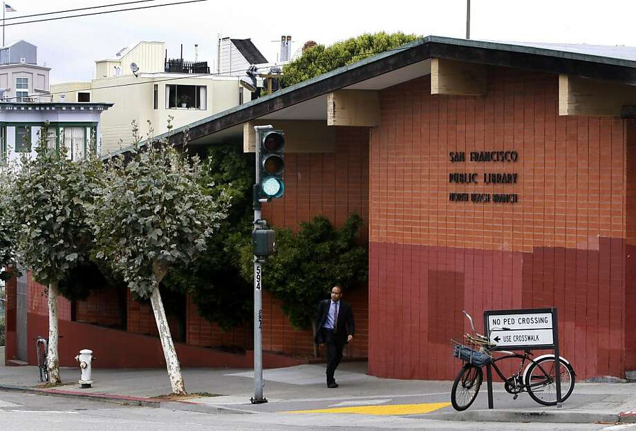 A man walks past the North Beach public library in San Francisco, Calif. on Thursday, Aug. 26, 2010. Preservationists are seeking landmark status on the building, which was built in 1958, and is scheduled for demolition to make way for a new library branch. Photo: Paul Chinn, The Chronicle