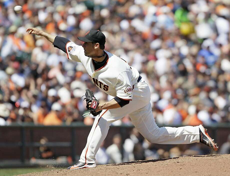 San Francisco Giants starting pitcher Ryan Vogelsong throws against the Arizona Diamondbacks during the seventh inning of a baseball game Wednesday, Aug. 3, 2011, in San Francisco. San Francisco won the game 8-1 to snap a five-game losing streak. Vogelsong was the winning pitcher. (AP Photo/Eric Risberg) Photo: Eric Risberg, AP