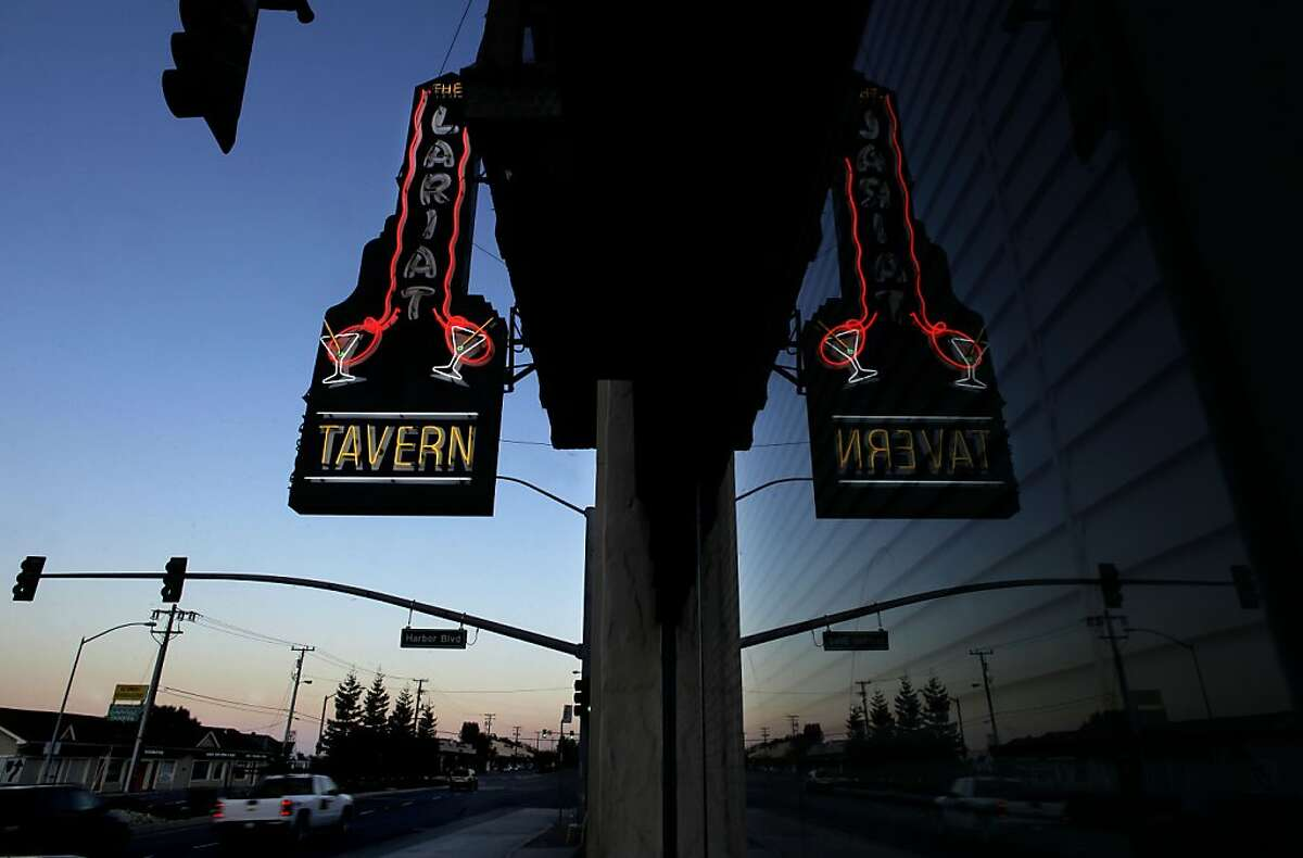 The neon sign outside the Lariat Tavern in Belmont, Ca. on Friday August 5, 2011. The many different architectural designs of buildings and the variety of signs along the El Camino Real from Millbrae south to Redwood City.