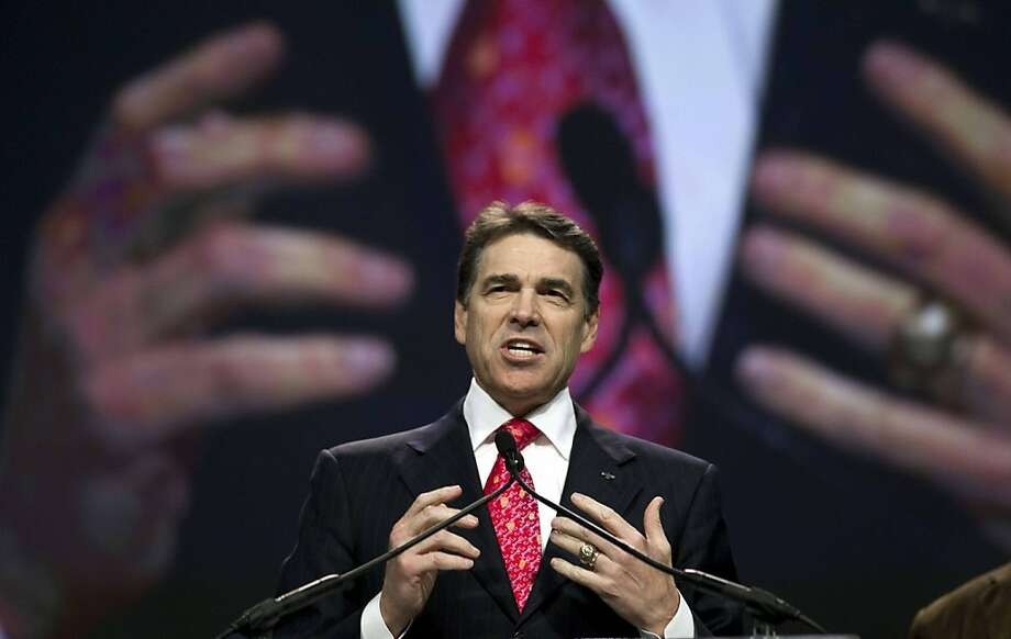 Texas Gov. Rick Perry speaks at The Response, a call to prayer for a nation in crisis, Saturday, Aug. 6, 2011, in Houston. Perry attended the daylong prayer rally despite criticism that the event inappropriately mixes religion and politics. Photo: David J. Phillip, AP