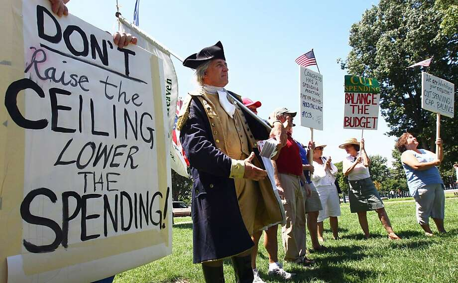 "WASHINGTON, DC - JULY 27:  Tea Party activists gather on Capitol Hill for a ""Hold the Line"" rally on June 27, 2011 in Washington, DC. With the debt limit impasse reaching a critical juncture, activists from all sides of the debate are reaching out to members of the U.S. Congress. Photo: Win McNamee, Getty Images"