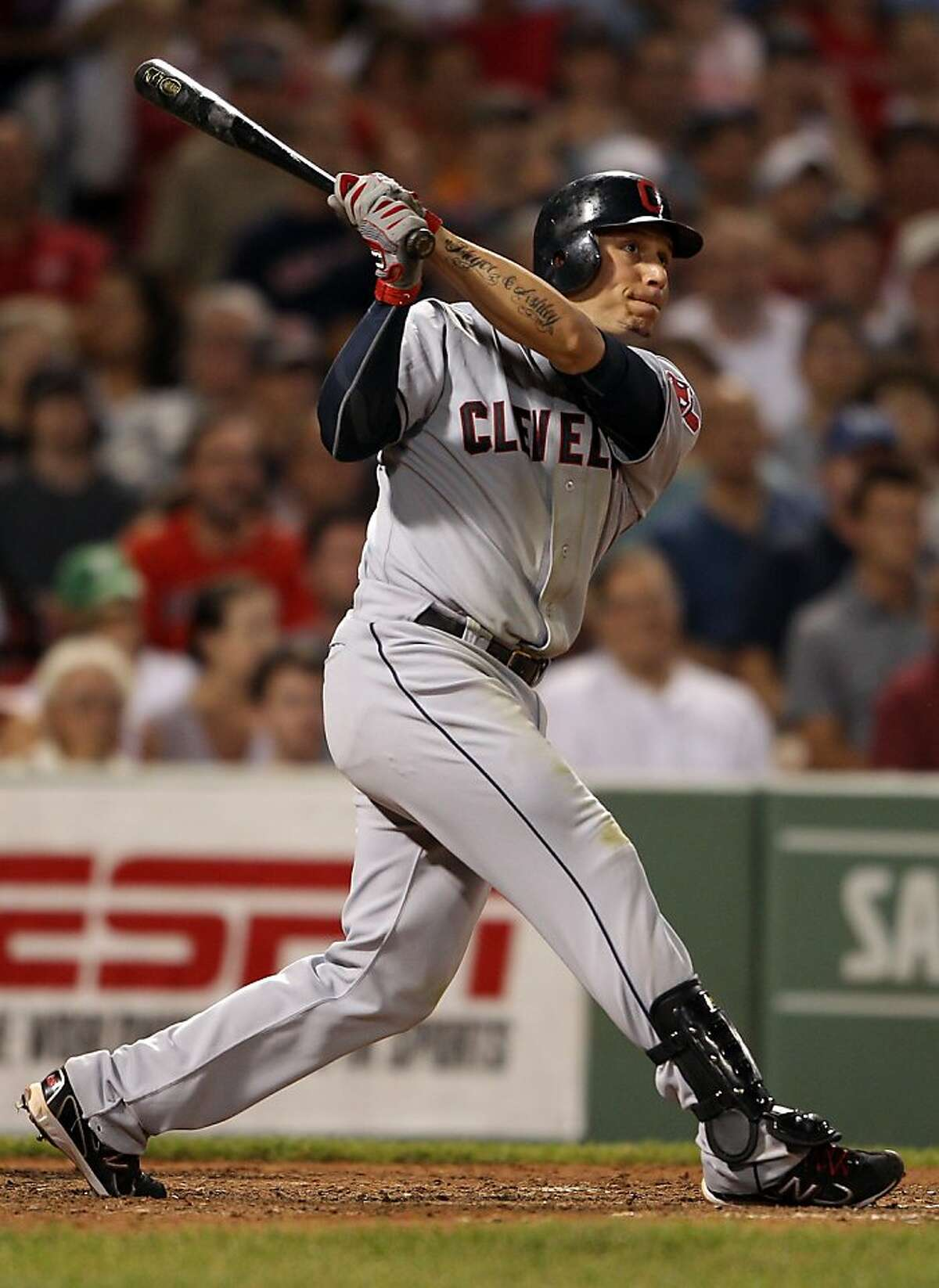 BOSTON, MA - AUGUST 01: Asdrubal Cabrera #13 of the Cleveland Indians watches his hit in the eighth inning against the Boston Red Sox on August 1, 2011 at Fenway Park in Boston, Massachusetts. The hit was ruled a two run homer after an official review.