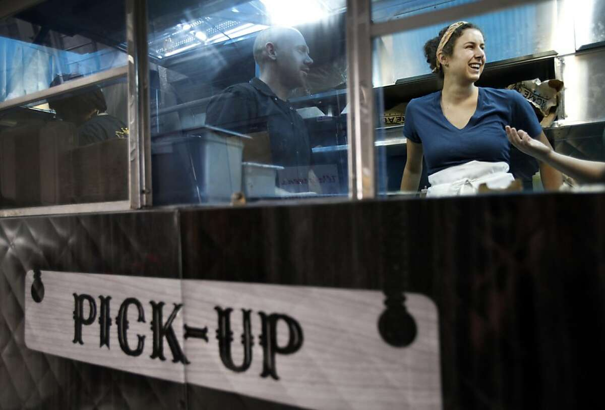 Caroline Hummer takes care of the lunch rush from her lunch truck, the Brunch Box, in San Francisco, Calif., Monday, August 1, 2011. Hummer will be eligible for free birth control and other reproductive care through President Obama's new health care guidelines.