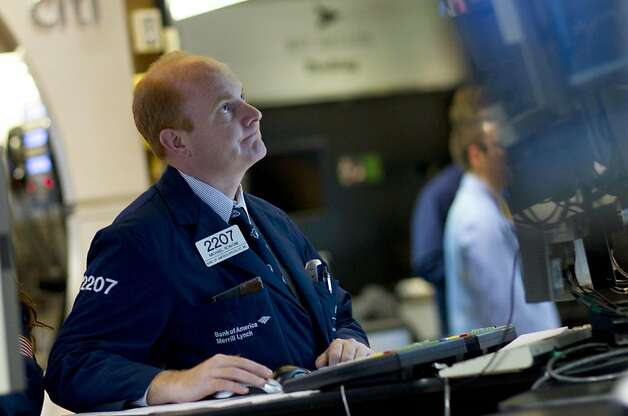 A trader works on the floor of the New York Stock Exchange on Thursday, Aug. 4, 2011 in New York.   Fears about the global economy led to the biggest panic in financial markets since the 2008 financial crisis. The Dow plunged nearly 513 points Thursday, its biggest point decline since Oct. 22, 2008. Photo: Jin Lee, AP