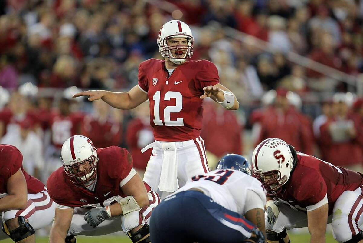 Quarterback Andrew Luck leads Stanford past the Arizona Wildcats at Stanford Stadium on Saturday.