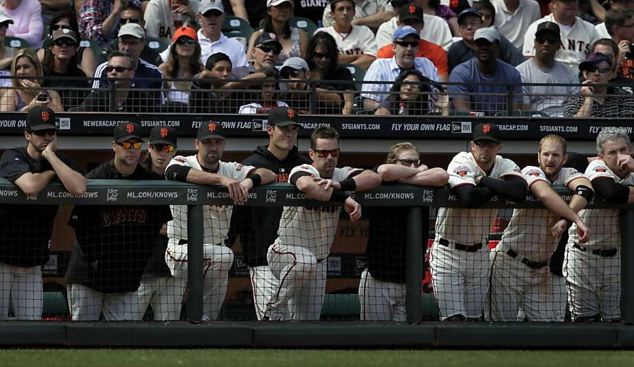 Players in the dugout look grim as the Giants lose to the Philadelphia Phillies, 2-1, at AT&T Park in San Francisco, Calif. on Saturday, August 6, 2011, their eighth loss in nine games. Photo: Paul Chinn, The Chronicle