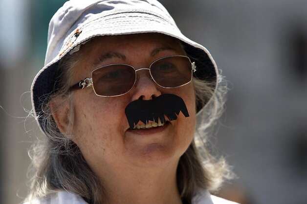 Jacquelyn Paull of San Francisco wears an Ed Lee mustache at a rally that to reveal the total number of signatures the Run Ed Run campaign has gathered to draft Ed Lee for mayor on  Monday, August 1, 2011 in San Francisco, Calif. Photo: Lea Suzuki, The Chronicle