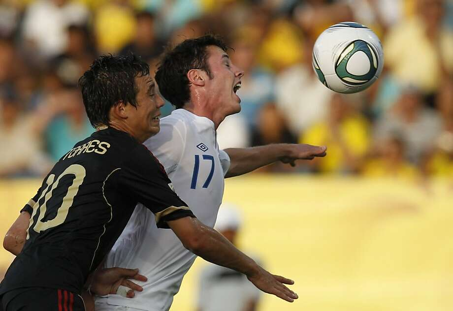 England's Adam Smith, fights for the ball with Mexico's Erick Torres during a U-20 World Cup group F soccer match in Cartagena, Colombia, Thursday, Aug. 4, 2011. Photo: Dolores Ochoa, AP