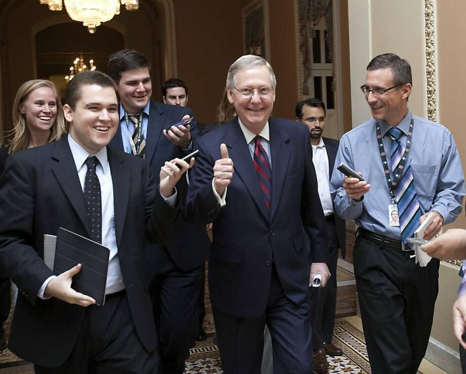 Senate Minority Leader Mitch McConnell, R-Ky., is all smiles as he walks to the Senate floor to announce that a deal has been reached on the debt ceiling on Capitol Hill in Washington, Sunday, July 31, 2011. Photo: Harry Hamburg, AP
