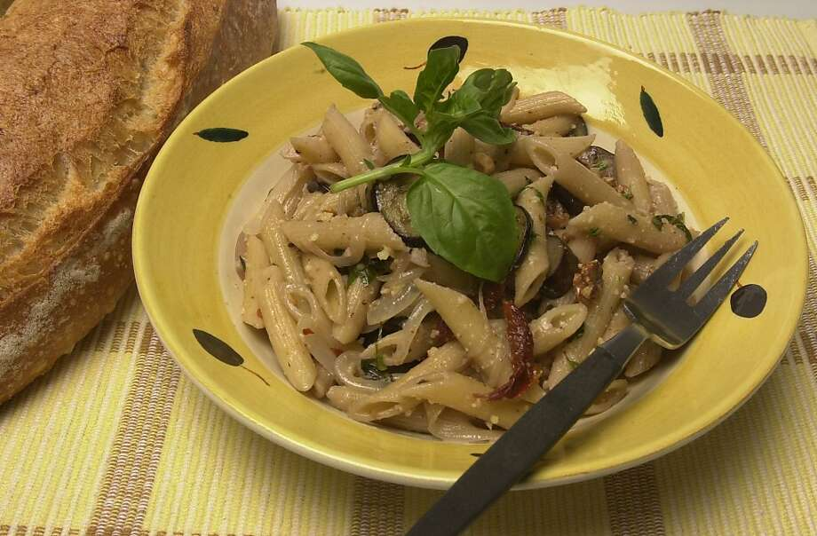 Penne pasta with walnuts, eggplant and basil pesto. Photo: Paul Chinn, The Chronicle
