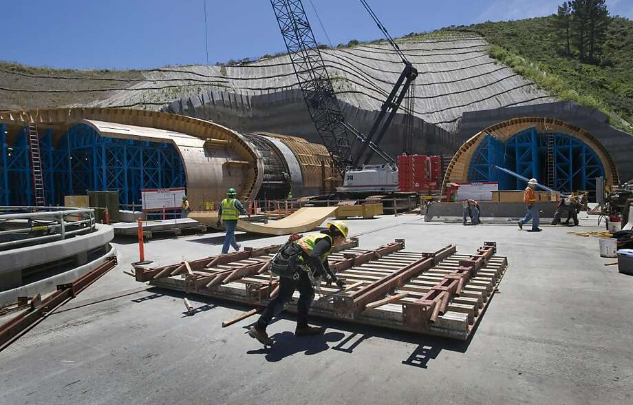 Workers hustle around the north end of at the Devil's Slide Bypass in Pacifica, Calif., on June 17, 2010. Photo: Chad Ziemendorf, The Chronicle