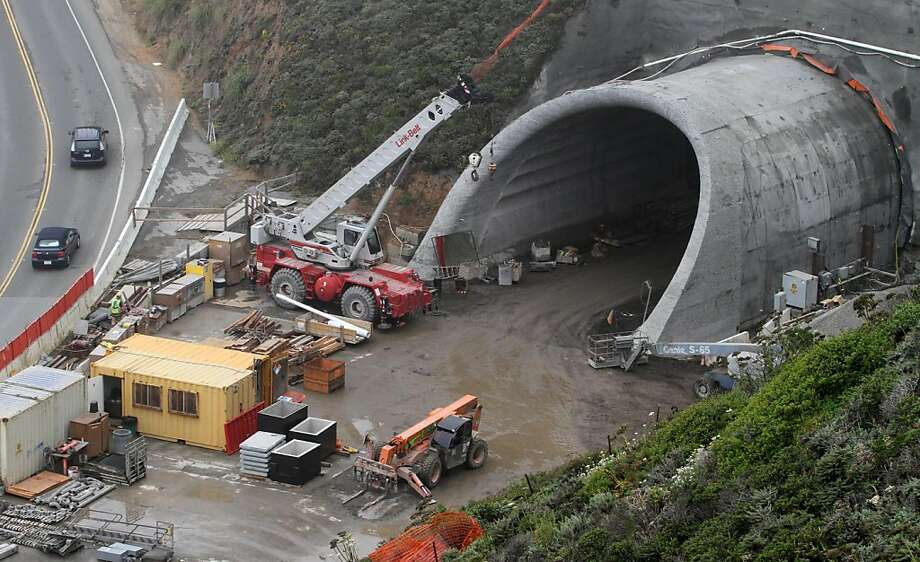 Cars pass by the south portal of the tunnel project along Devil's Slide Thursday, August 4, 2011. Photo: Mathew Sumner, Special To The Chronicle