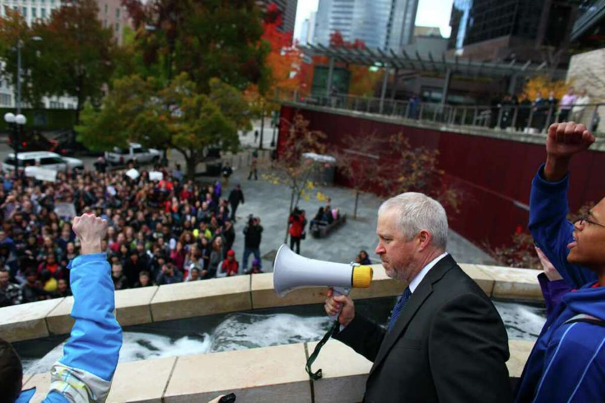 Seattle Mayor Mike McGinn addresses Garfield High School students on the steps of Seattle City Hall. The students walked out to protest proposed education cuts now being considered during a special legislative session in Olympia.