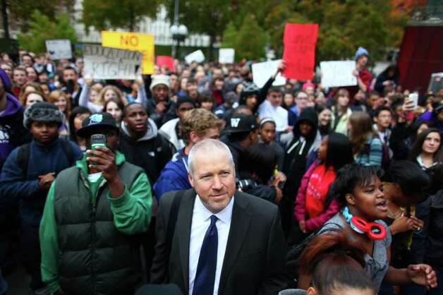 Seattle Mayor Mike McGinn listens to student speakers in front of City Hall during a walkout by hundreds of Garfield High School students on Wednesday, November 30, 2011. People at the rally said about one third of the student body walked out to protest proposed education cuts now being considered during a special legislative session in Olympia. Photo: JOSHUA TRUJILLO / SEATTLEPI.COM