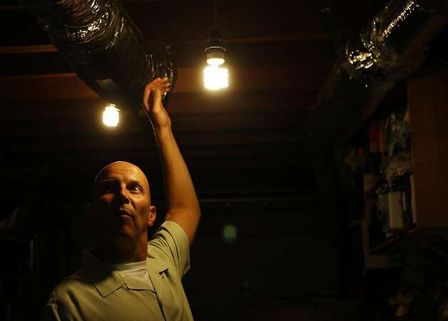 Brian Johnson stands in his home on Tuesday, August 2nd in San Francisco, Calif. San Francisco has a program that offers rebates up to $7,000 for homeowners who make their homes more energy efficient, installing energy-saving windows and insulation for example. The program is funded with money from the US Department of Energy. Photo: Maddie McGarvey, The Chronicle
