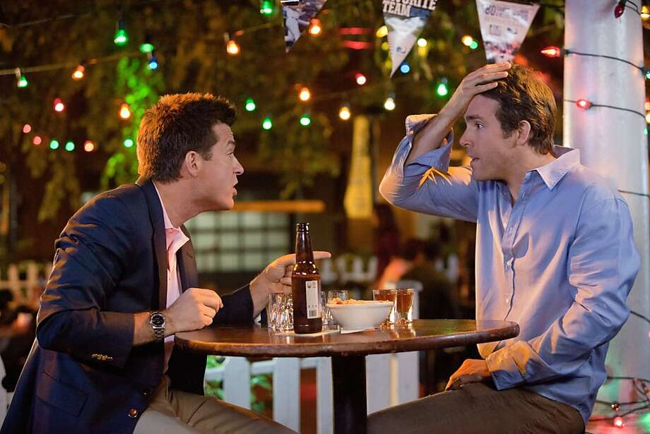 """(L to R) Dave (JASON BATEMAN) and Mitch (RYAN REYNOLDS) get smashed in """"The Change-Up"""", the new comedy from the director of Wedding Crashers and the writers of The Hangover that takes the body-switching movie where it's never gone before. Photo: Richard Cartwright, Universal"""