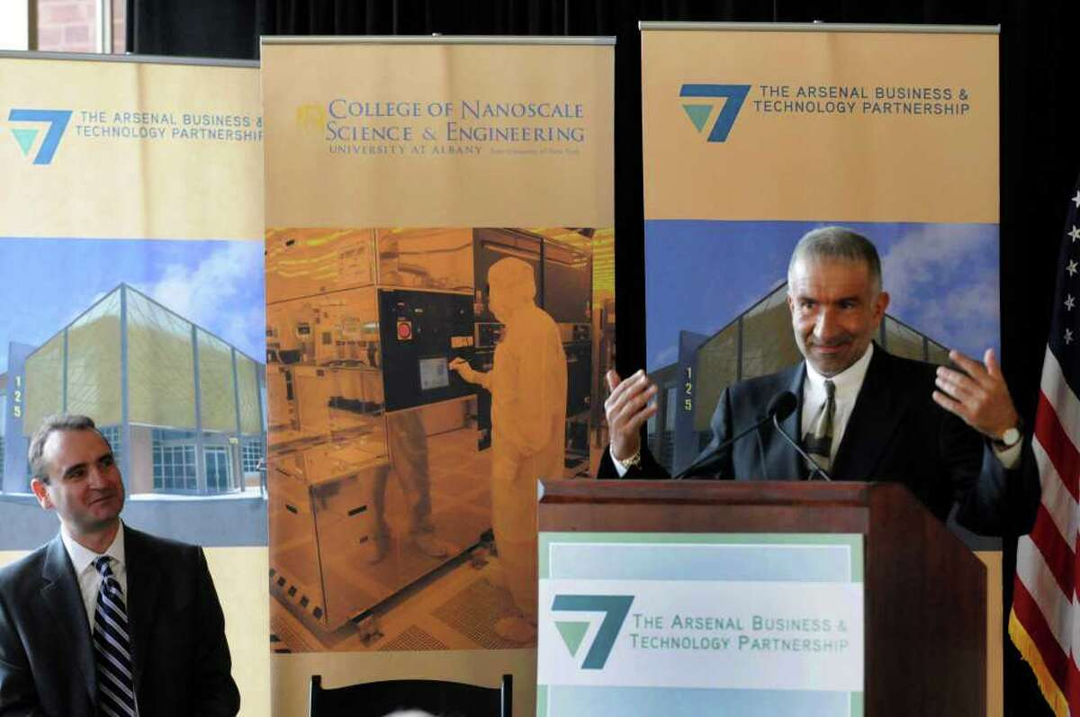 Dr. Alain E. Kaloyeros, senior vice president and CEO of CNSE, right, introduces Panos Angeloppolos, president of Cleveland Polymer Technologies, left, during a press conference to announce Angeloppolos's company moving their headquarters and expanding operations at the Watervliet Arsenal in Watervliet, NY Wednesday, Nov.30, 2011.( Michael P. Farrell/Times Union)