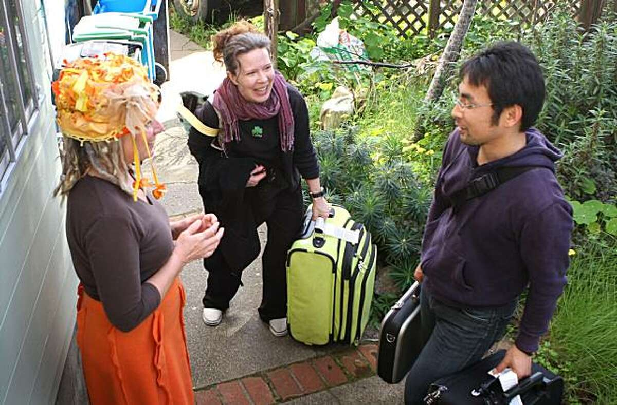 Opal Essence (left) greets Lisa Shinkawa and Tomo Shinkawa who arrived from Japan and will stay at her Post Apocalyptic retreat house during their visit in the city. San Francisco, Calif. Wednesday March 17, 2010.