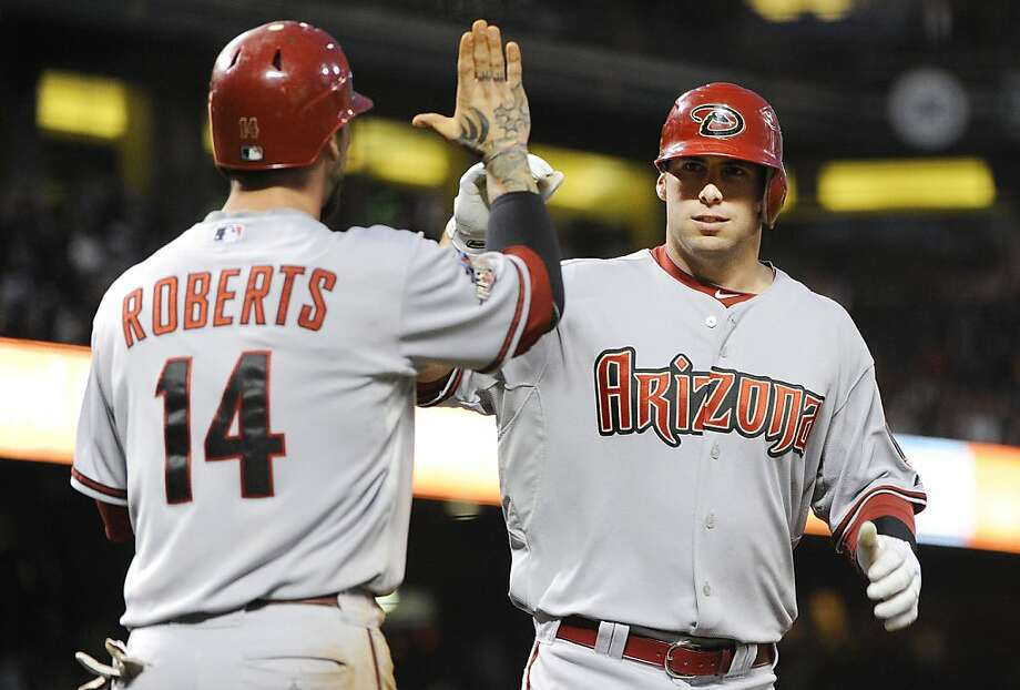 SAN FRANCISCO, CA - AUGUST 2:  Paul Goldschmidt #44 of the Arizona Diamondbacks celebrates with Ryan Roberts #14 after hitting a two-run home run against the San Francisco Giants in the fifth inning  during an MLB baseball game at AT&T Park August 2, 2011in San Francisco, California. Photo: Thearon W. Henderson, Getty Images