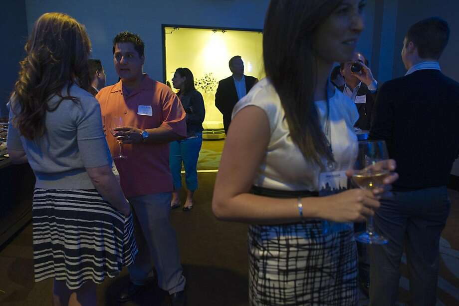 Michael DeFrenza, 34 of San Rafael, 2nd left talks with iloverewards.com recruiter Kate Pope during a recent cocktail recruitment party in San Francisco, California, U.S., on Thursday July 21, 2011.  Photographer: David Paul Morris/Bloomberg *** Local Caption *** Michael DeFrenza;Kate Pope Photo: David Paul Morris, Bloomberg
