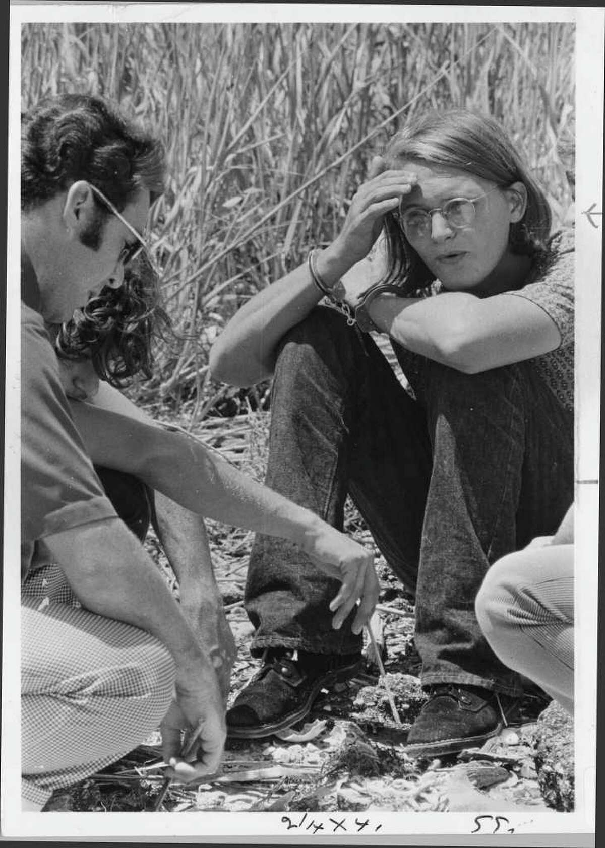 David Owen Brooks, another one of Dean Corll's accomplices, is shown at a crime scene around 1973.